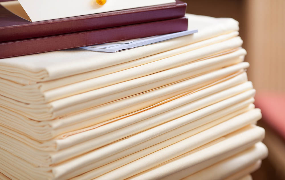 Selective focus of stacked tablecloths in restaurant